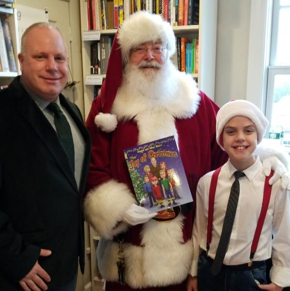 Ken Keeney with Riley and Santa at River Bend Bookshop